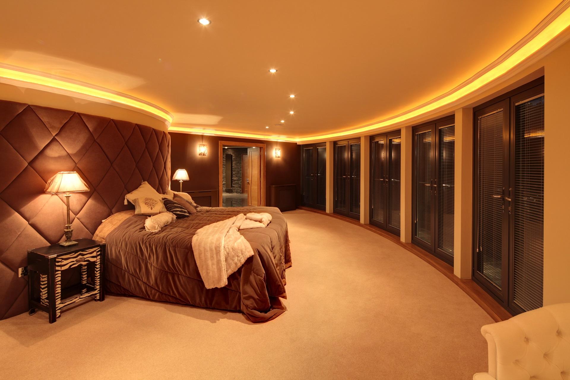 circular bedroom suite, hall view. Luxury homes by Guy Phoenix