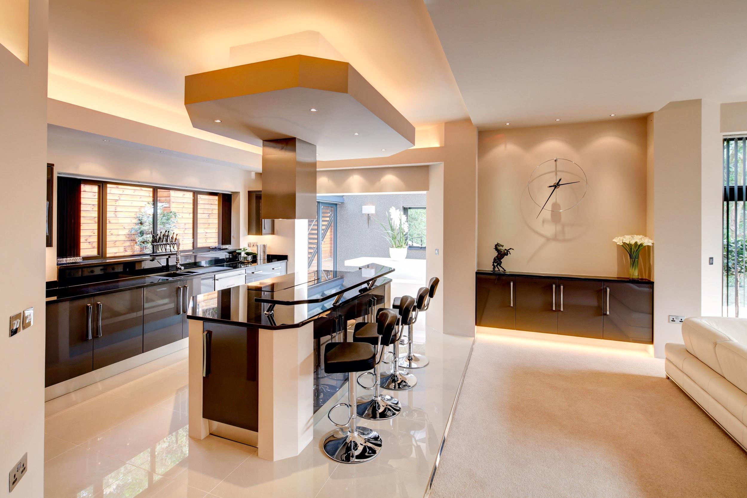 Breakfast bar in designer kitchen, luxury homes at Alexandra Park by Guy Phoenix