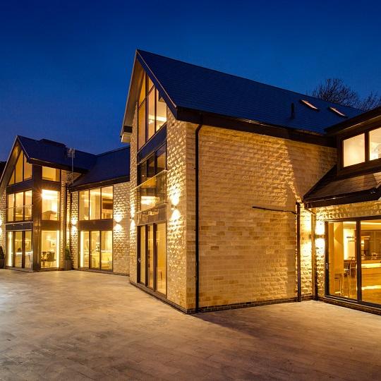 Dusk shot of luxury house in Colston Basset