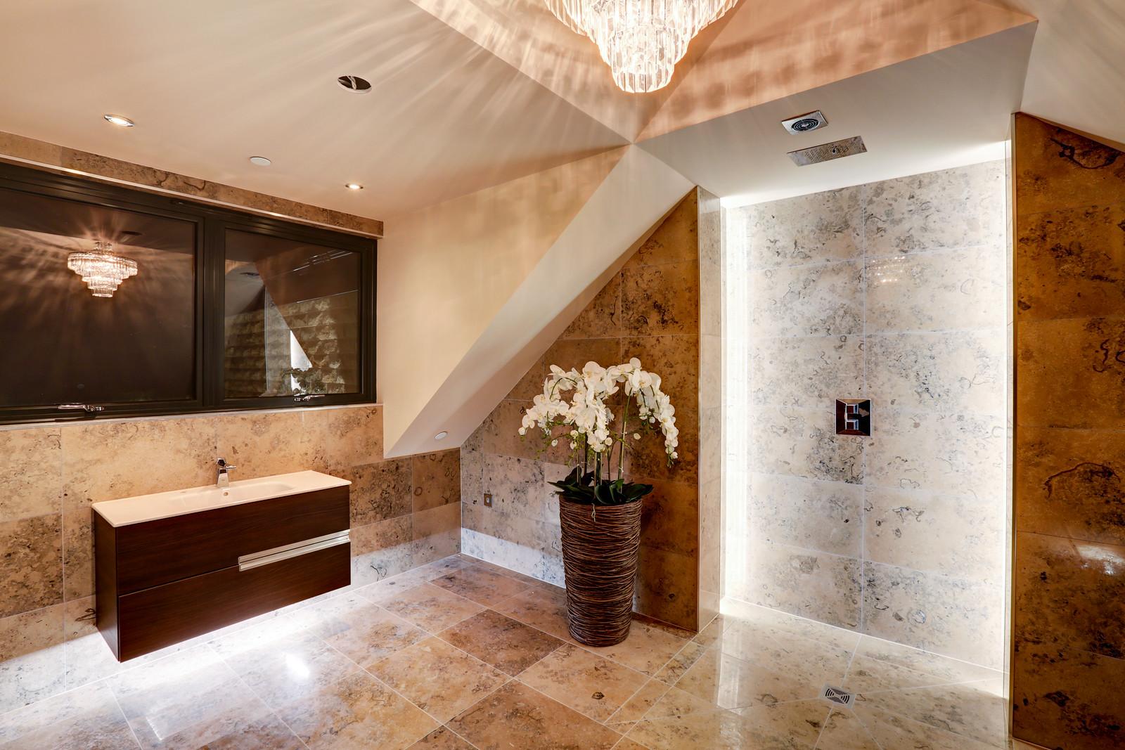 Shower room in marble, Tanglewood, Colston Bassett by Guy Phoenix
