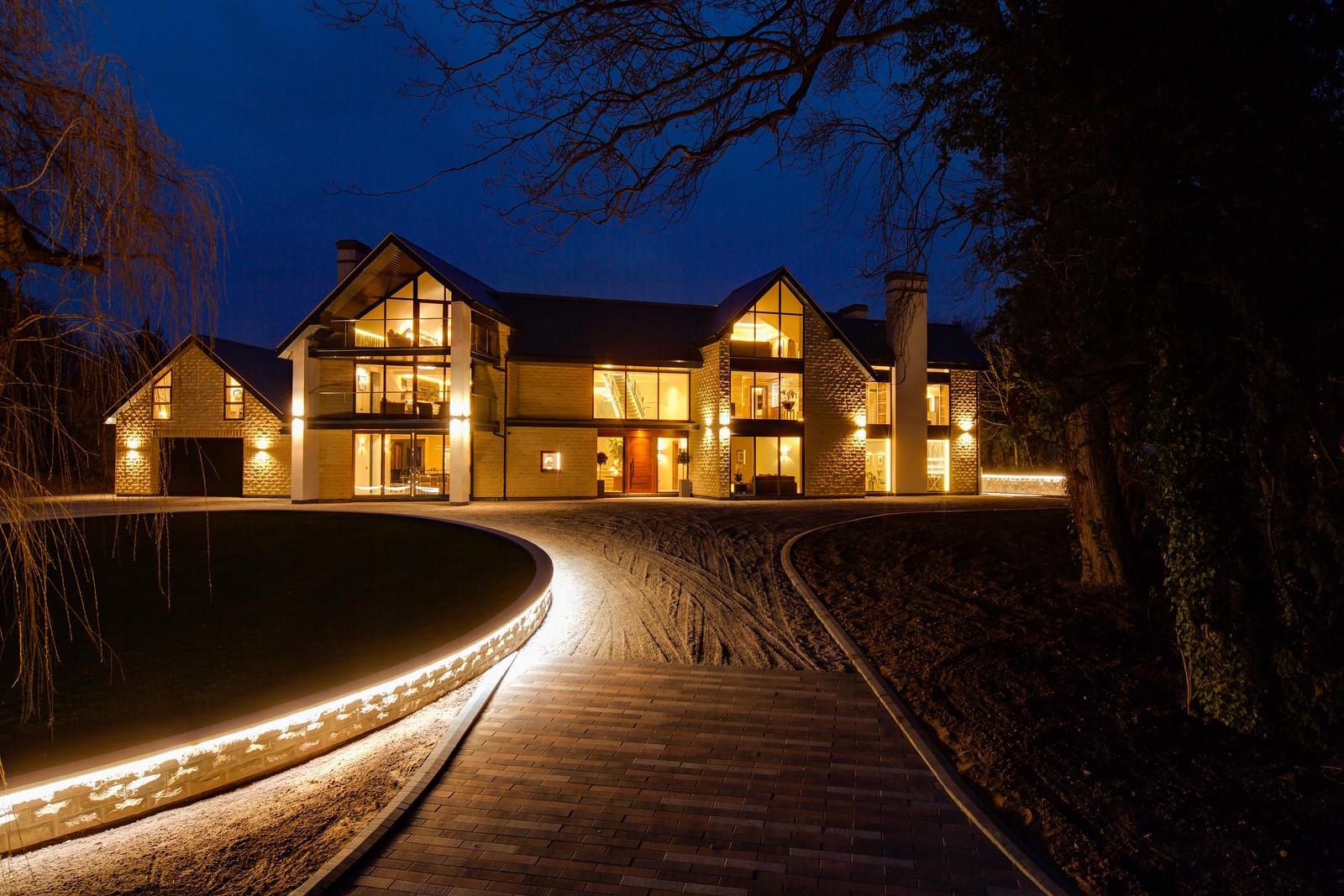 Tanglewood, Colston Bassett, luxury home at dusk by Guy Phoenix
