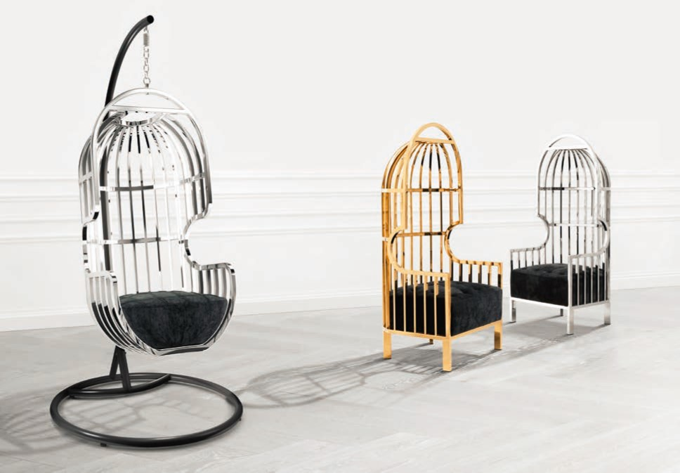 Eichholtz swing chair in gold and chrome. Available from Guy Phoenix