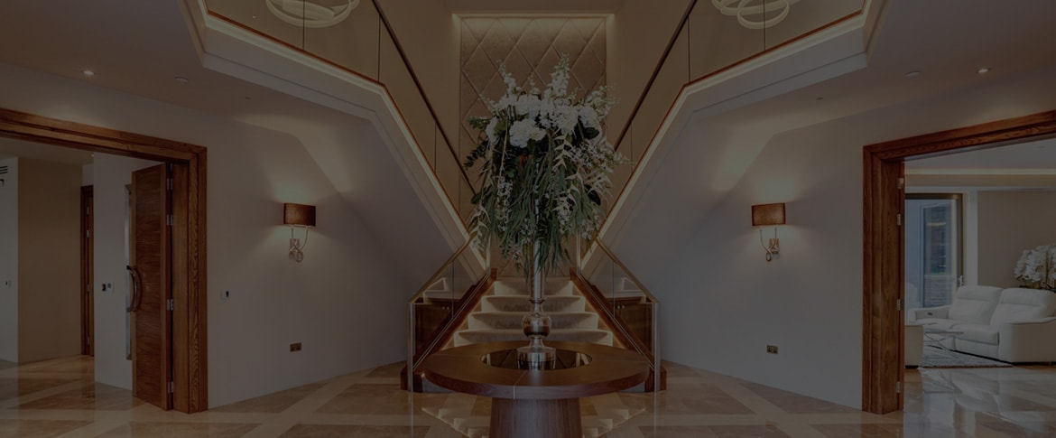 Grand entrance hallway with flower arrangement