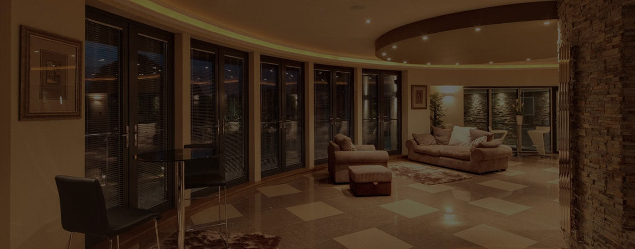 curved wall living area, bi fold doors and marble floor