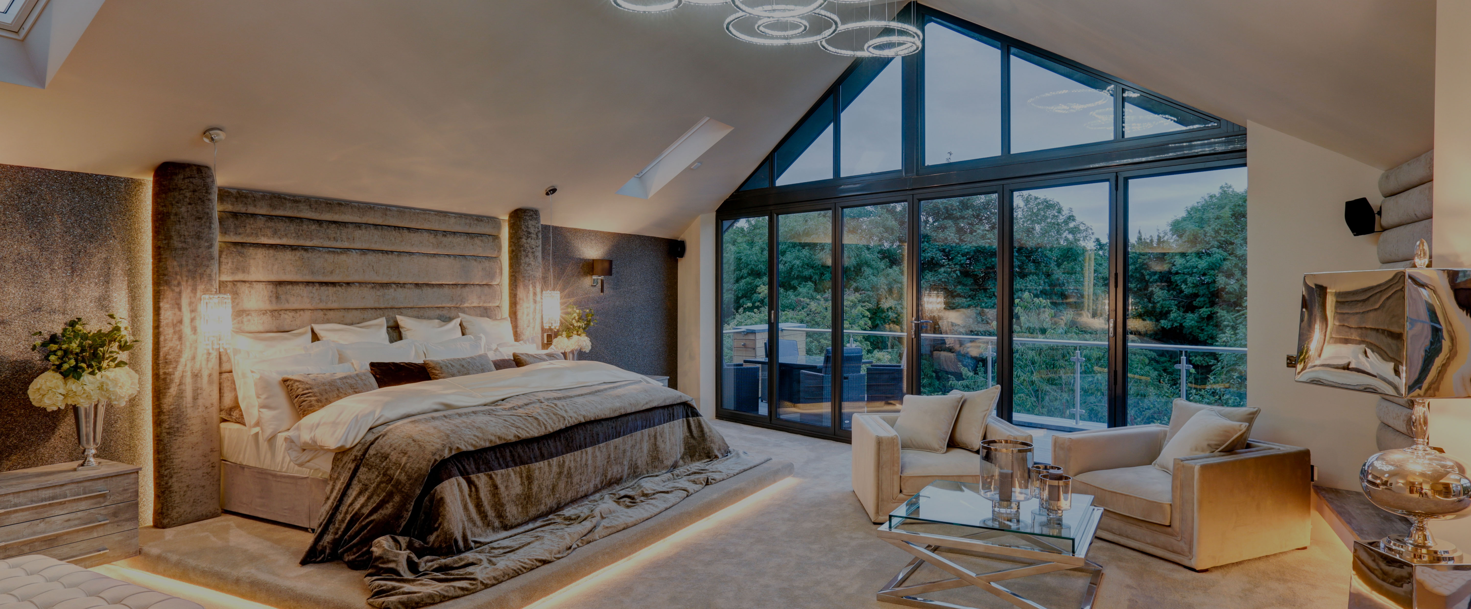 Bedroom suite with bi-fold doors, glass pitched roof and balcony