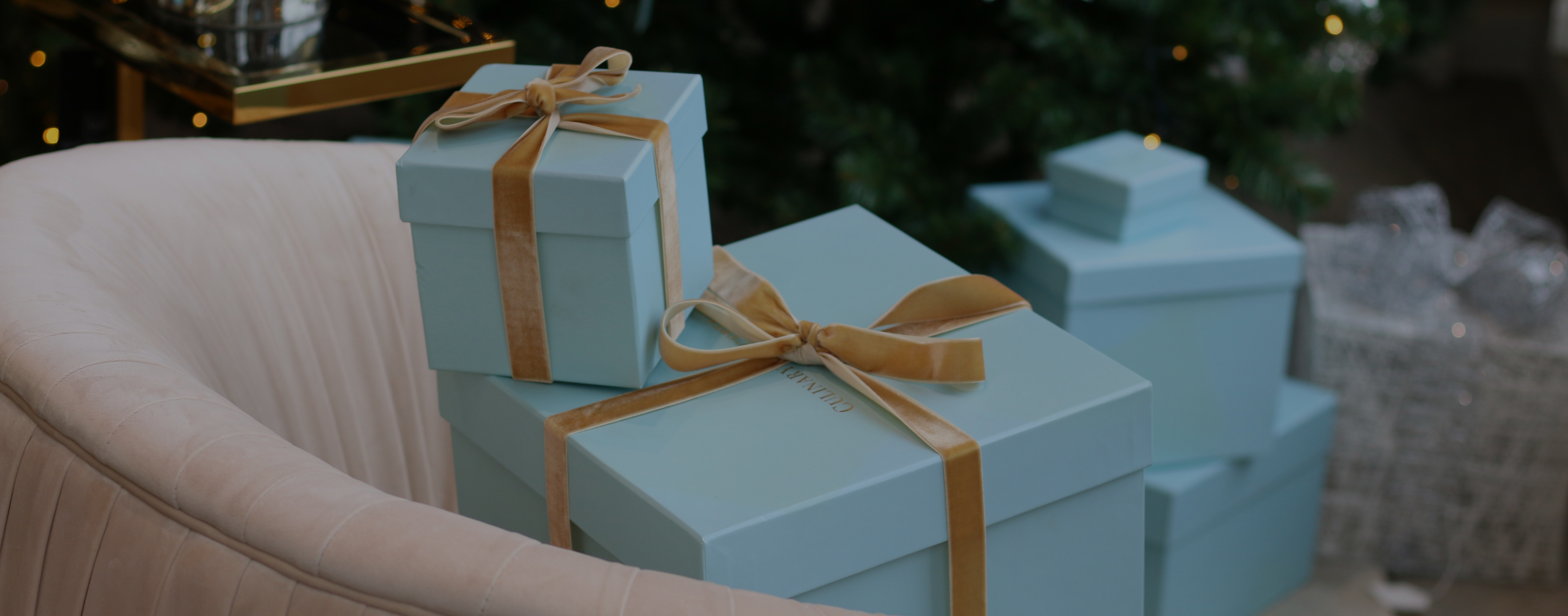 Blue Christmas boxes with gold ribbon