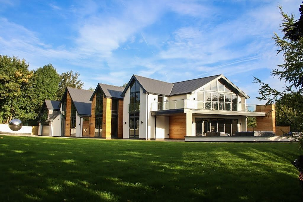 Contemporary home, pitched roof, bi fold doors leading to balcony